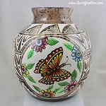 Horsehair pottery with hand painted butterfly and carved designs