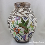 Horsehair pottery with hand painted hummingbird and carved designs