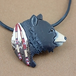 Black Bear pendant/pin carved from buffalo bone then hand painted