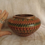 Red clay pottery with geometrics designs and horse hair embedded into clay