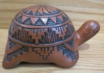 Red clay turtle pottery with geometric designs