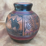 Hand carved pottery with bear, warrior and geometric designs