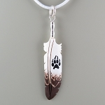 Bone carved eagle feather with wolf paw painted pendant