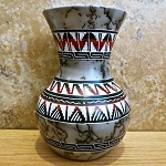 Geometric designs carved all around, horse hair pottery