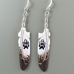 Bone carved eagle feather with wolf paw painted earrings