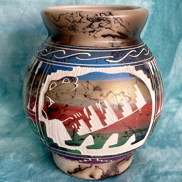 Horse hair pottery with bear and feather designs
