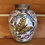 Horse hair pottery with hand painted butterfly, flowers and hand carved designs all around