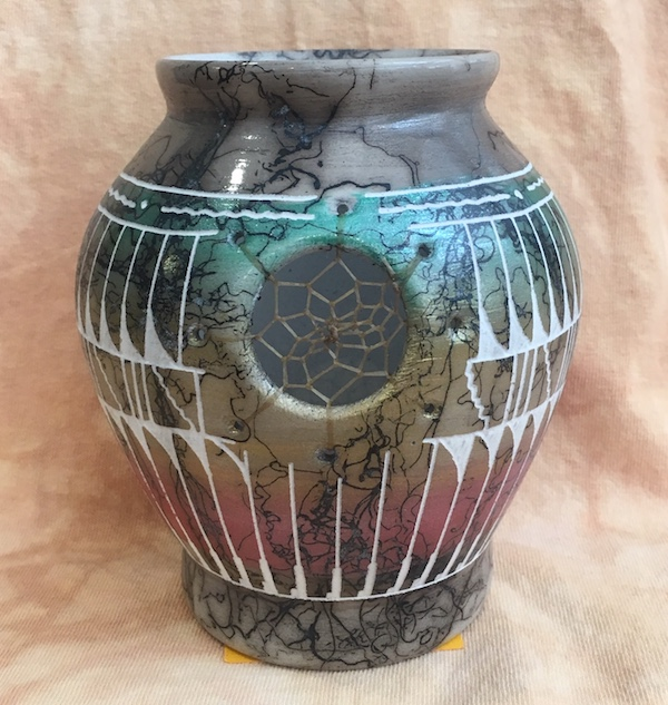 Horse hair pottery with woven dream catcher and feather designs