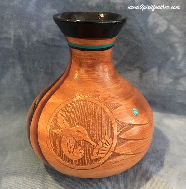 Native American woodgrain pottery with hummingbird effigy and geometrics designs