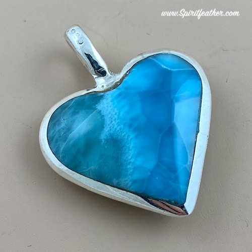 Larimar Heart Shaped pendant with beautiful silky texture in different shades