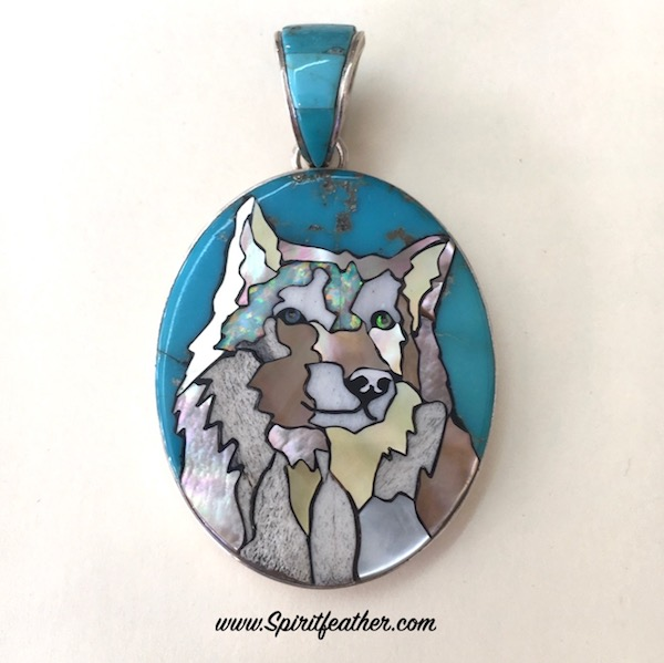 Wolf Inlaid with stones and shells and Turquoise background