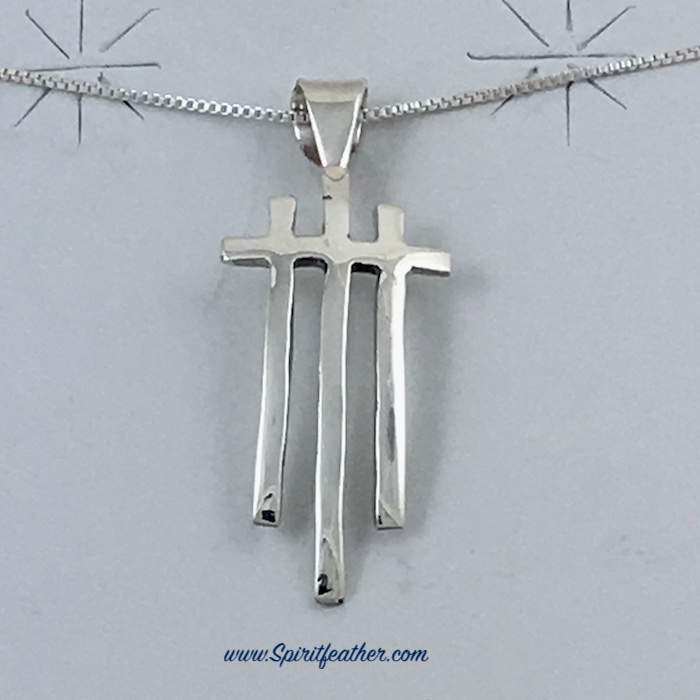 Three Crosses Pendant in Sterling Silver and comes on an 18