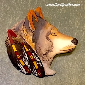 Wolf pendant/pin carved from buffalo bone then hand painted