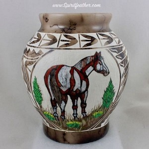 Horse hair pottery with hand painted horse and carved designs all around